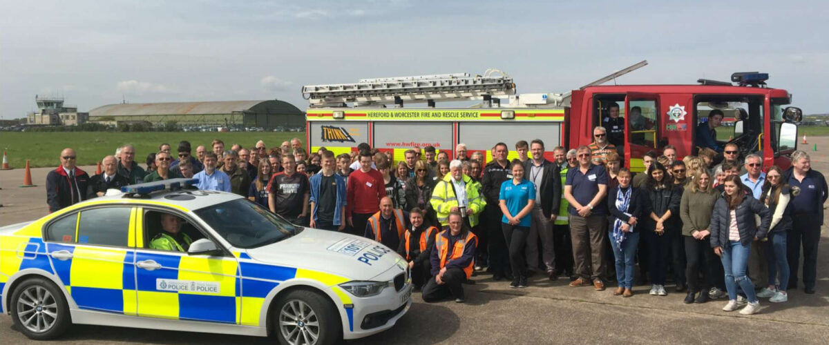 John Campion and large group with Police car and Fire Engine