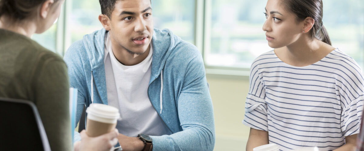 Young adults discuss issues during support group session